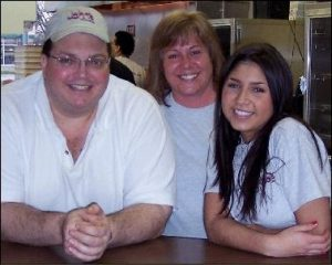 Phil Bacino with front counter staffers Diane and Brittani.